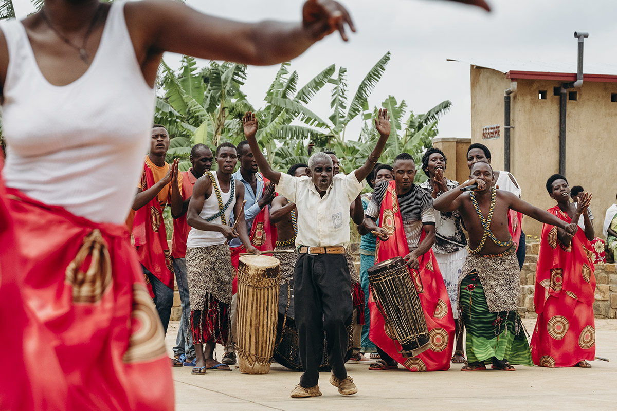 Elder Rwandan man gets into the beat and dances to a traditional drum band during celebrations for International Women's Day in Masoro, Rwanda